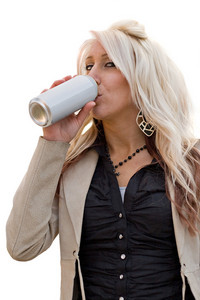A young woman drinking from an aluminum can with a blank label.