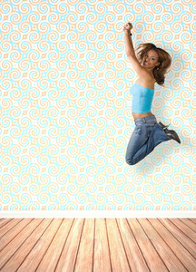 A young woman jumping in the air indoors in front of an interior decorated with vintage wallpaper.
