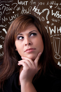 A young woman thinks deeply about something. Conceptual doodle question words float in the background.
