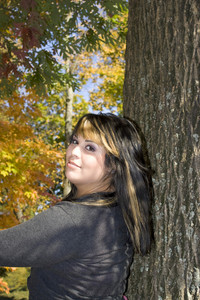 A young woman with highlighted hair in a new england setting during autumn.