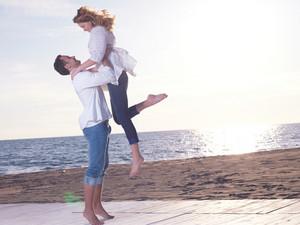 Young Couple  On Beach Having Fun