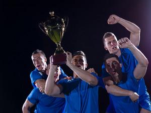 Soccer players celebrating victory