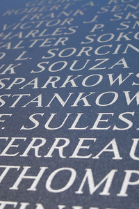 Abstract closeup of engraved names on the Iwo Jima war memorial.