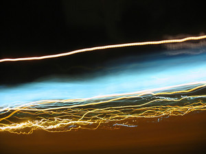 Abstract light trails captured from cars, signs, and other landmarks.