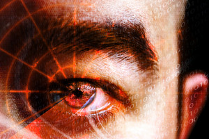 Abstract montage of a mans eye with a radar grid overlaying the pupil.  Shallow depth of field. Great concept relating to cyber crime hackers or identity theft.