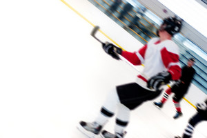Abstract motion blur of hockey players on a fast break as they speed down the ice.