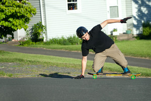 Action shot of a longboarder skating on the street.