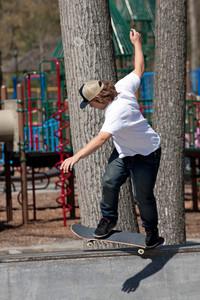 Action shot of a skateboarder skating on a concrete skateboarding ramp at the skate park.