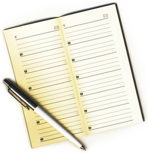 Address Book And A Pen On A White Background Isolated-
