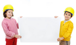 Adorable boy and girl dressed worker whit a billboard a over white backround