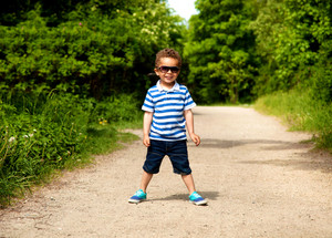 Adorable kid posing for the camera is excited for the summer vacation