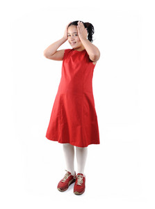 Adorable  preteen school  girl wearing red dress isolated