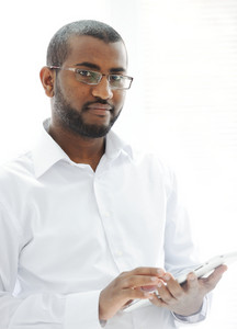 African American Arabic person with pc tablet