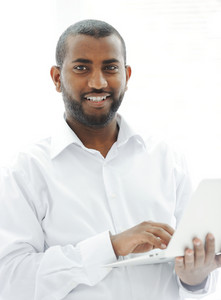 African American businessman with a laptop