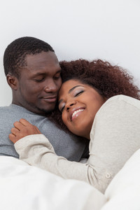 African couple sleeping