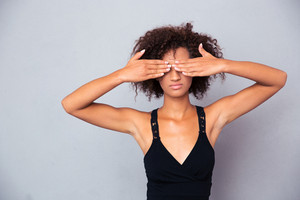 Afro american woman covering her eyes