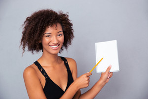 Afro american woman showing blank notebook