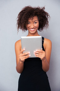 Afro american woman using tablet computer