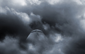 airplane flying through a heavy storm