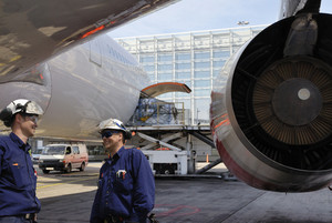 airplane mechanics and loading plane for flying