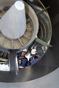 airplane mechanics inside large jet-engine
