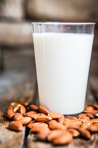 Almond Milk On Rustic Wooden Table