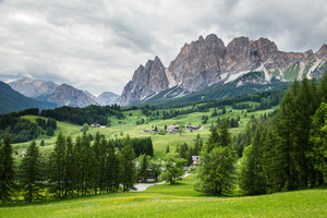 Amazing view on Cristallo Mountains with alpine village on sunny summer day, , The Dolomites Mountains, Italy