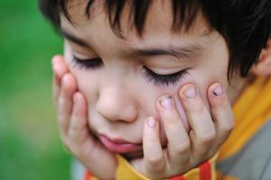 an a beautiful kid , sad