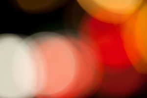 An abstract bokeh background with circular blurred light blobs. A great art element.