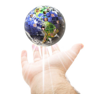 An abstract conceptual montage of a hand holding up the earth filled with people of all different races nationalities and background.  Great for social media and communications concepts.