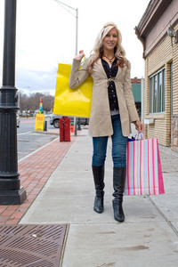 An attractive blonde woman out shopping in the city.