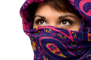 An attractive woman wearing a traditional head covering.