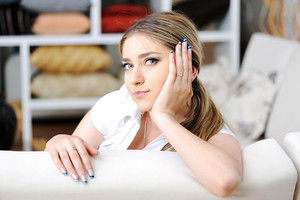 An attractive young woman lying on the couch at home