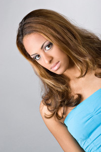 An attractive young woman with a serious look on her face.