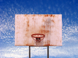 An basketball hoop found in an urban park over a blue sky - includes clipping path.