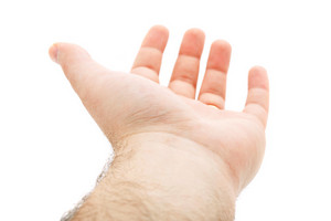 An empty hand being held out over a blank white background.