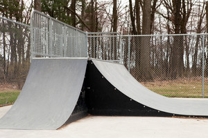 An empty set of ramps at an outdoor skate park.