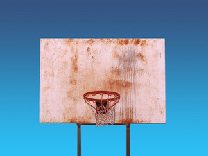 An isolated basketball hoop over a blue background - includes clipping path.