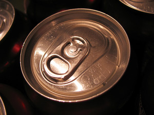 An isolated beverage can top - close up.