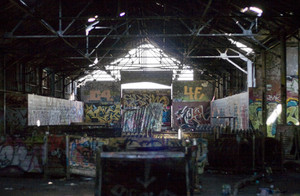 An old abandoned area that has been converted to a paint ball course. Every inch is covered with graffiti.