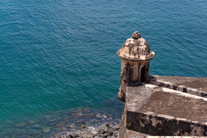 An old decaying tower of El Morro fort located in Old San Juan Puerto Rico.