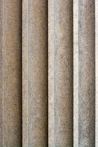 An old stone column texture on the exterior of a building.