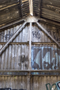 An old structure that is covered with graffiti.