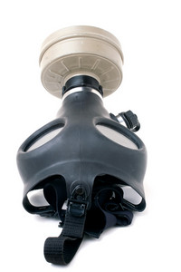 An old worn gas mask with black rubber isolated over white.