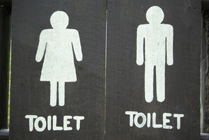 Ancient toilet sign on wood