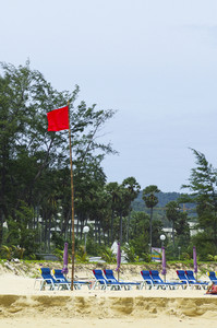 Andaman beach with red flag for danger zone