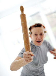 Angry older woman with rolling pin