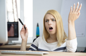 Angry woman working on compute
