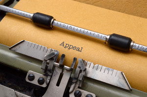 Appeal Text On Typewriter