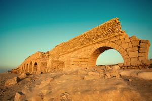 Aqueduct in ancient city Caesarea in Israel